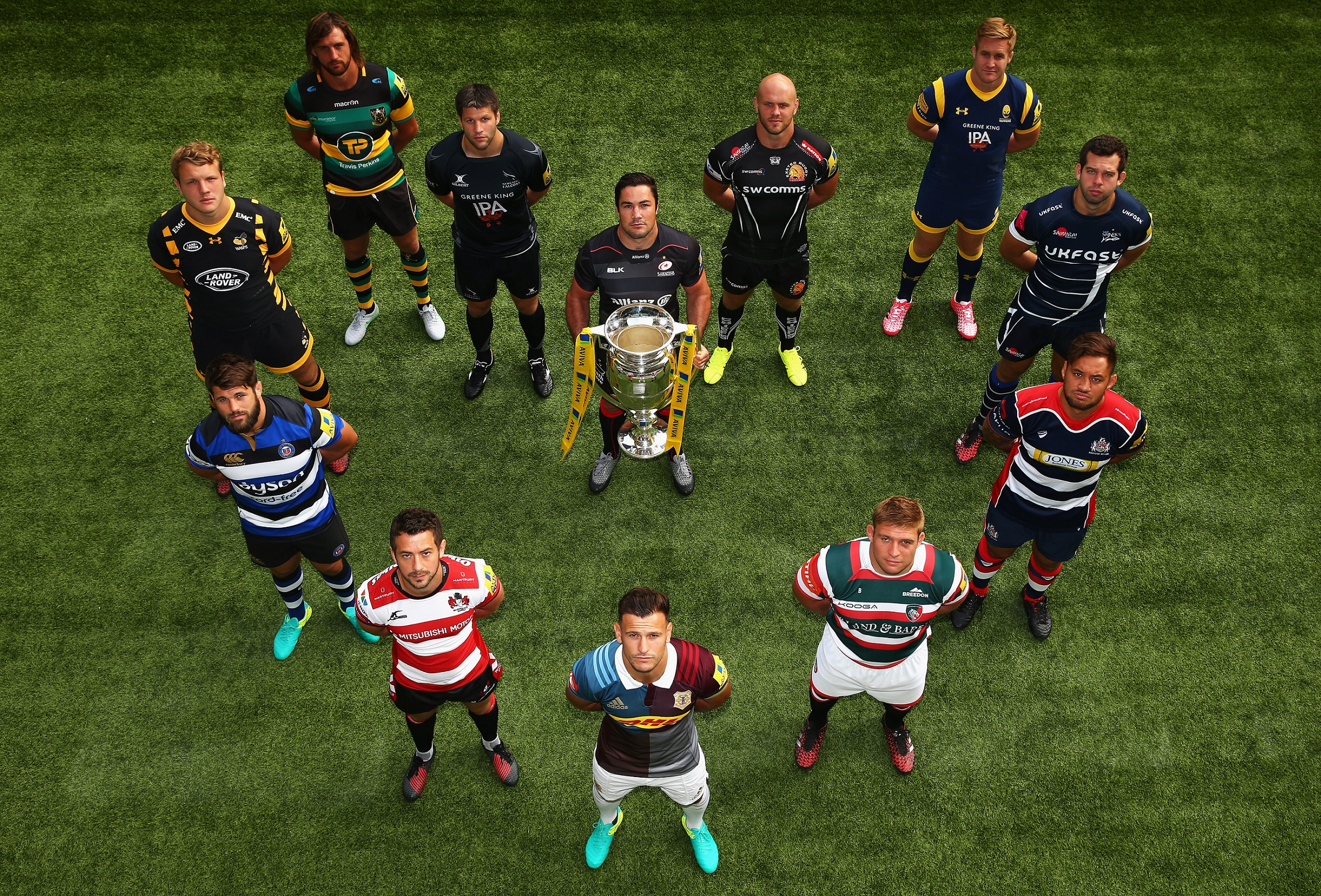 LONDON, ENGLAND - AUGUST 25: Brad Barritt, Captain of Saracens, holds the Aviva Premiership Trophy, as the twelve Captains form a heart shape at the Aviva Premiership Rugby Season Launch at Twickenham Stadium on August 25, 2016 in London. The heart shape symbolises the Aviva Community Fund initiative which launches on 13 September 2016. The initiative lends a helping hand to local communities, including grassroots sports clubs, by offering funding of up to £25,000. during the Aviva Premiership Rugby 2016-2017 Season Launch at Twickenham Stadium on August 25, 2016 in London, England. (Photo by Steve Bardens/Getty Images for Aviva)
